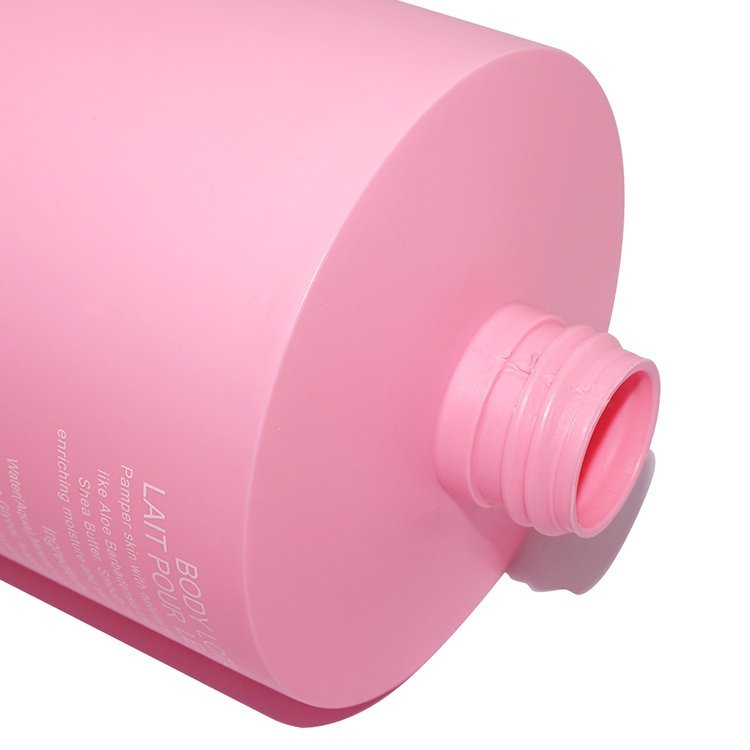 Empty 500ml pink color cylinder shape plastic HDPE cosmetic body lotion bottle manufacturer with lotion pump wholesale