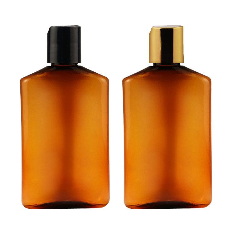 Factory wholesale new 100ml 200ml transparent amber flat PET plastic cosmetic shampoo bottle with flip top screw cap