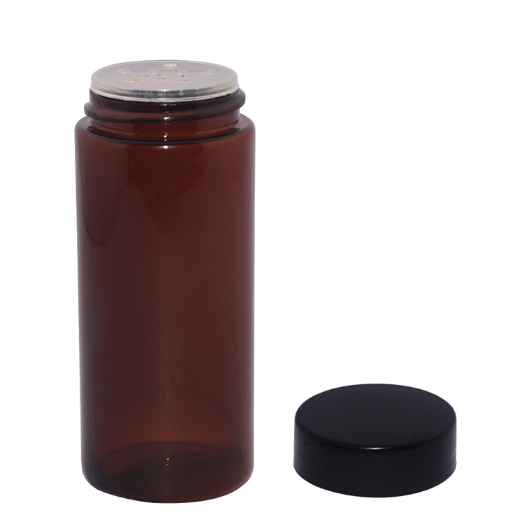 China factory 70ml amber color empty round cosmetic PETG plastic talcum powder bottle with screw sifter lid
