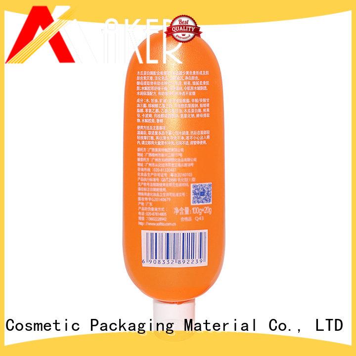 New design 100ml flat shape orange squeeze PE plastic cosmetic cream bottle with flip top cap